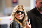 Stacy 'Fergie' Ferguson flashes the peace sign before going through the body scanner at Los Angeles LAX Airport.  Fergie was given special treatment as she was allowed to keep her sunglasses on.