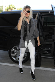 Fergie was masculine-chic at LAX in a slouchy button-down shirt by Unravel.
