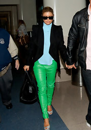 Fergie embraced on trend brights in a pair of lime leather pants.