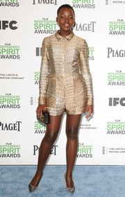 Lupita Nyong'o traded in her fab gowns for a patterned gold Stella McCartney romper when she attended the Film Independent Spirit Awards.