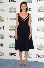 Aubrey Plaza went for classic chic at the Film Independent Spirit Awards in a black fit-and-flare Preen dress with gold trim.