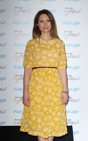 Myanna Buring looked ready for springtime with this yellow floral frock.