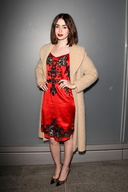 Lily Collins added a sophisticated touch with lacy Jimmy Choo pumps at the Flaunt Magazine Issue Party.