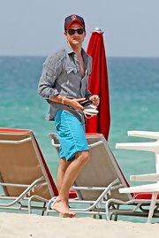 Jared Followill paired a gray button-down with blue board shorts while spending an afternoon on the beach.