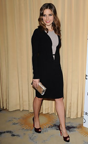 Sophia Bush added shine to her demure black-and-nude long-sleeved dress with a metallic box clutch.