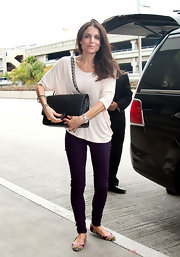 Bethenny Frankel arrived at LAX sporting a casual pair of multi-colored ballet flats.