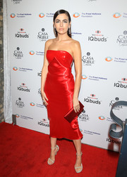 Camilla Belle captivated in a strapless red liquid lamé dress by Ralph Lauren at the Fred Hollows Foundation fundraising gala.