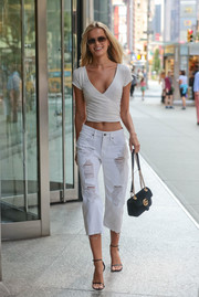 Frida Aasen styled her casual look with black skinny-strap sandals.