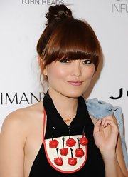 Hana showed off her bold bangs with this twisted top knot bun.