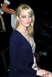 Emma Stone attended the Louis Vuitton Fall 2011 fashion show wearing Cloud Freeform earrings in 18-karat yellow gold with diamonds.