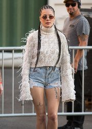 Halsey paired her shorts with an equally eye-catching feathered turtleneck.