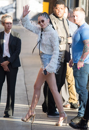 Halsey teetered on towering nude platforms while headed to 'Kimmel.'