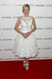 Amanda Holden complemented her white dress with platform sandals from  Nicholas Kirkwood.