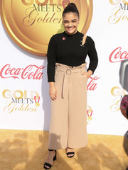 Laurie Hernandez paired her top with high-waisted beige trousers.