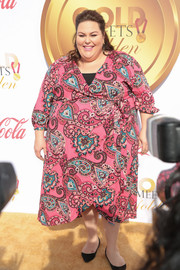 Chrissy Metz made a vibrant choice with this pink paisley wrap dress for the Gold Meets Golden event.