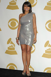 Taraji P. Henson shined at the Grammy Nominations Conceert in a metallic lame' cocktail dress.