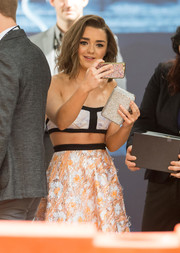 Maisie Williams headed to the LA premiere of 'Game of Thrones' season 6 carrying a beaded silver clutch.