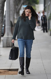 Jennifer Garner finished off her cozy look with a flat pair of boots that were perfect for the gloomy weather.