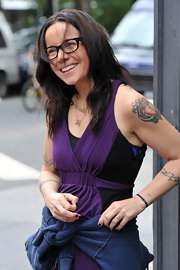 Janeane has an elaborate heart tattoo on her left shoulder. She has another heart tattoo design on her right shoulder as well.