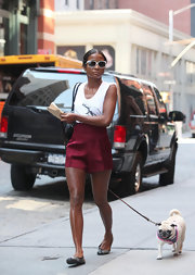 Genevieve Jones looked chic in white-rimmed square sunglasses while walking her dog.