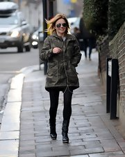 Geri Halliwell opted for a cool and casual look with this camouflage utility jacket while taking her daughter to school.