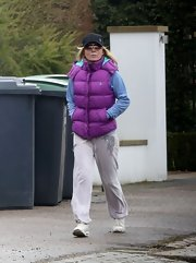 Geri Halliwell chose a bright purple puffer vest to bundled up during a walk.