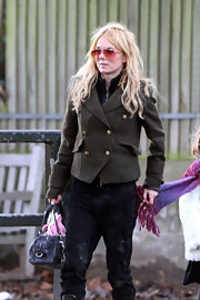 Geri Halliwell hit the streets in an olive military style pea coat.