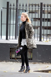 Geri donned black buckled ankle boots with a pair of black leggings. The singer wore the boots over purple socks, which added a slight pop of color.