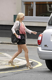 Geri looked summer chic pairing her satin shorts with lace-up cutout booties.