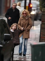 Geri Halliwell went for a stroll in a sweet hooded camel coat.