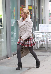 Ger Halliwell looked too hot to trot in a pair of gray suede ankle boots. She paired the lace up boots with matching tights and a school girl skirt.