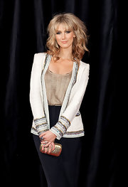 Delta Goodrem sparkled at the 'Get Him to the Greek' premiere in this sequined jacket, metallic top, and gold hard-case clutch combo.