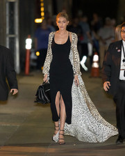 Gigi Hadid pulled her diva-worthy outfit together with a pair of black multi-strap heels by Stuart Weitzman.
