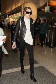 Gigi Hadid put her slim legs on display in a pair of J Brand skinny jeans while making her way through LAX.