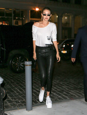 Gigi Hadid's platform sneakers added several more inches to her towering height.