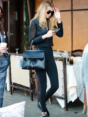 Gigi Hadid showed off her slim pins in a pair of black leggings, also by Alo.