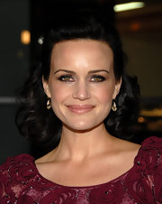Carla Gugino amped up her look with a smoky shadow rimed around her lids.