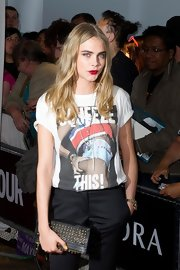 Cara Delevigne carried a studded leather clutch at the Glamour Awards.