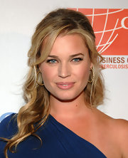 Rebecca Romijn highlighted her half up hairstyle with gold hoops accented by diamonds.