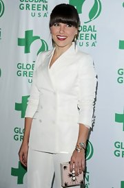 A pink square-shaped clutch added some color to Sophia Bush's all-white suit.