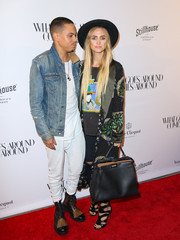 Ashlee Simpson spruced up her jeans and tee with an embellished coat by Etro for the opening of What Goes Around Comes Around.