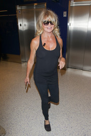 Goldie Hawn looked ready for a workout in a black tank top and a pair of leggings while catching a flight.