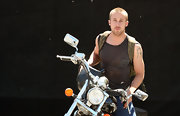 Ryan Gosling looked biker chic as he showed off his arm tattoo.