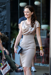 Leighton Meester paired her sand colored dress with a gold bangle bracelet.