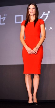 Sandra Bullock donned a simple Roland Mouret dress in a striking red hue to promote 'Gravity' in Tokyo.