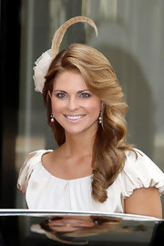 Princess Madeleine played up her hairstyle by accentuating it with an attention grabbing fascinator as she graced the Monaco Royal Wedding.