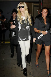 Taylor Momsen wore a bronze pendant in the shape of a bullet to the G-Star Raw show during Mercedes-Benz Fashion Week.