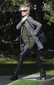 Gwen Stefani was fall-chic in a gray wool coat layered over an olive green mini while picking up Zuma from school.