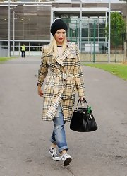 Gwen wore her signature plaid while out for the day with her family.