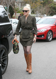 Gwen Stefani continued the edgy-chic vibe with a pair of camel-colored knee-high boots.